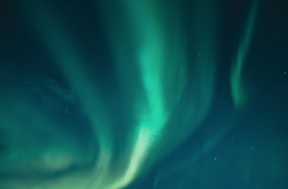Auroras are produced when the magnetosphere is sufficiently disturbed by the solar wind that the trajectories of charged particles in both solar wind and magnetospheric plasma, mainly in the form of electrons and protons, precipitate them into the upper atmosphere (thermosphere/exosphere) due to Earth's magnetic field, where their energy is lost.