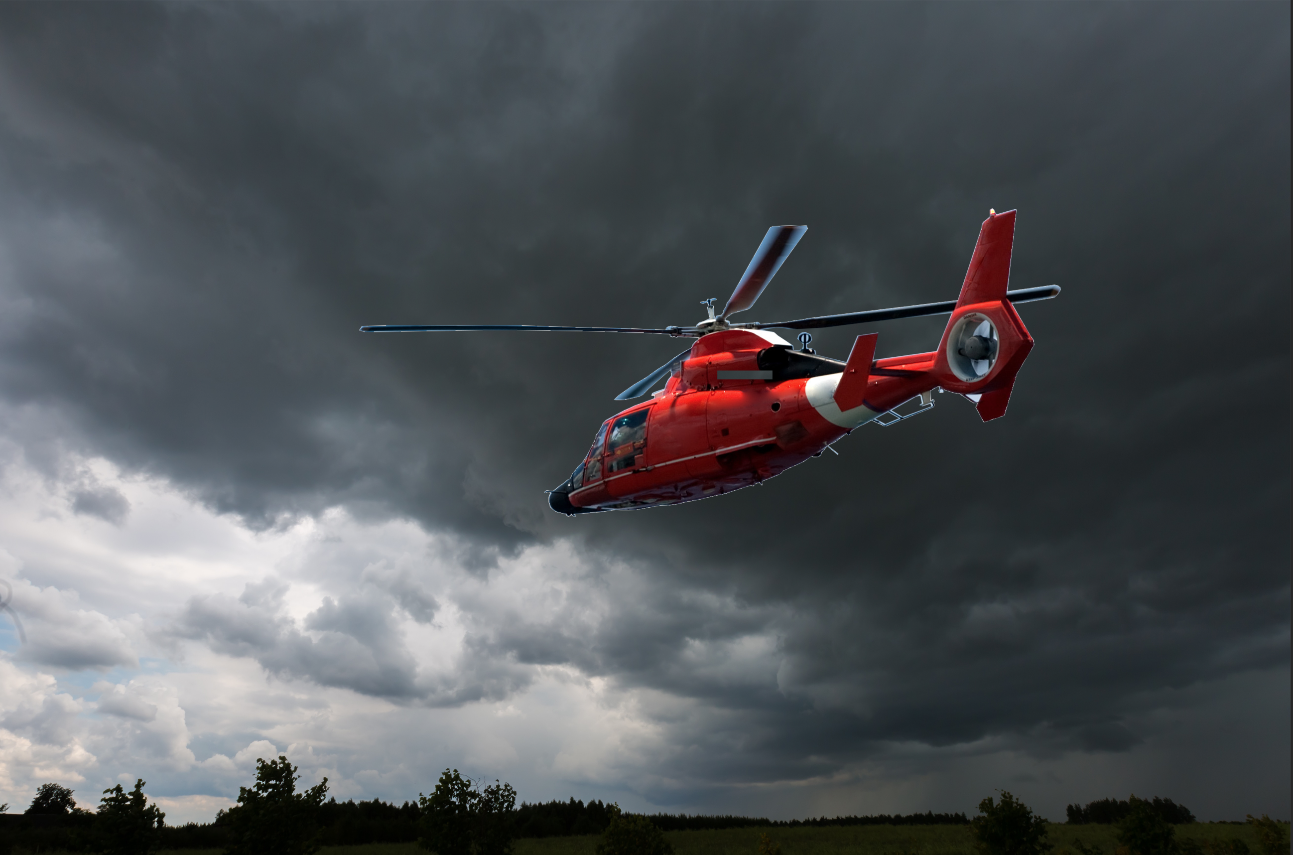 Helicopter in storm search