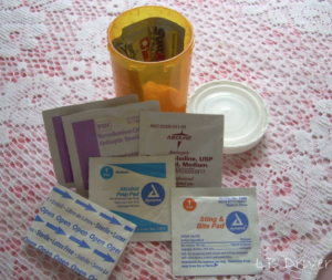 Prescription bottle first aid kit for camping